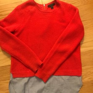Red Jcrew sweater with blue shirt lining